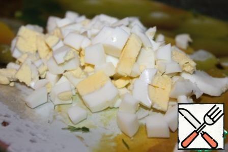 Chop boiled eggs.