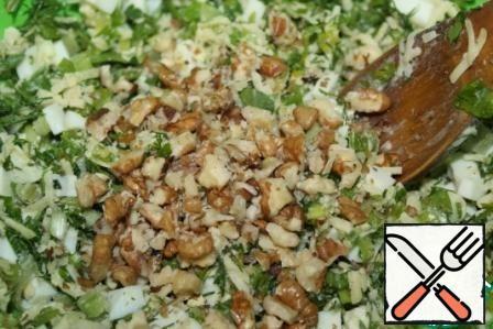 Add chopped walnuts and mix.