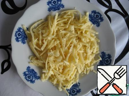 Three cheese on a coarse grater.