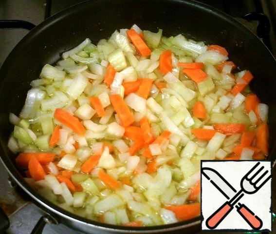 Fry the carrots, onions and celery for a couple of minutes in oil.