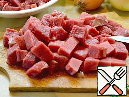 Cut the beef into pieces the size of a small walnut ( or slightly smaller).