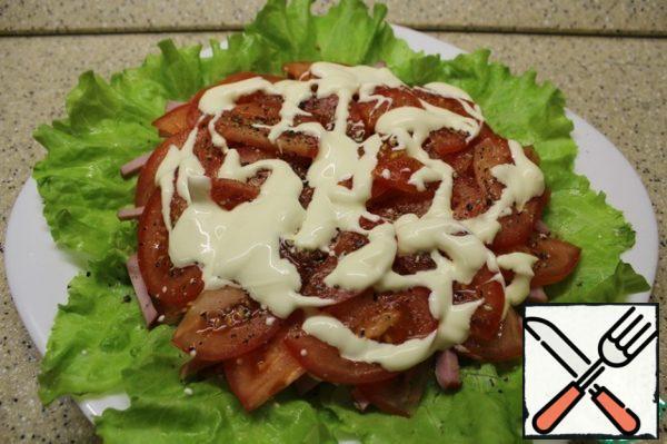 On top of ham-tomato slices, salt, pepper, seasoned sauce.