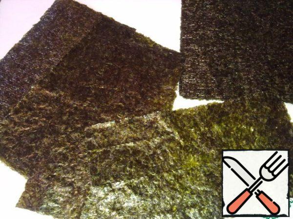 Sheets nori cut in half.