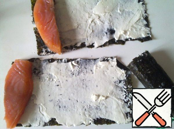 Fillet-a piece of salmon peel and cut into 4 pieces, wrap the fish in sheets of nori cheese.