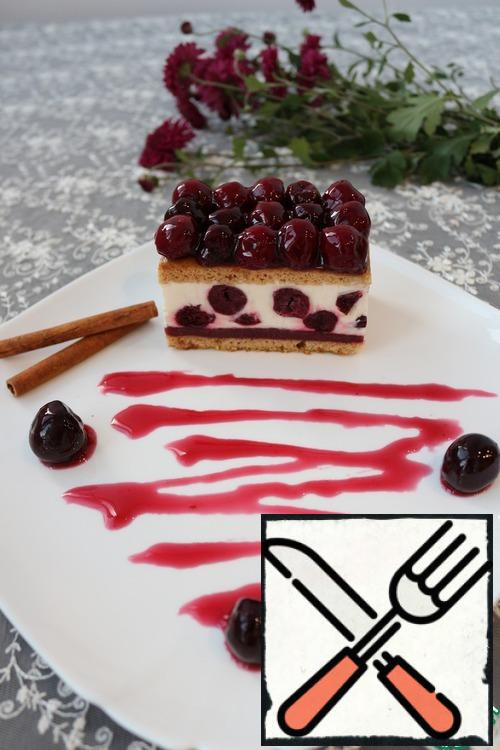 Ready dessert cut into portions. Before serving, decorate the top of the remaining cherries and put the dessert in the refrigerator for 30-50 minutes. Bon appetit!