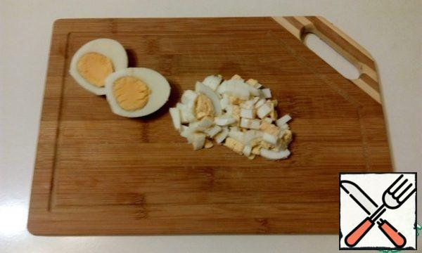 Boil eggs, cool and cut into cubes.