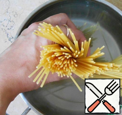 Cook pasta.