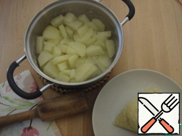 Millet boiled in salted water and boiled potatoes.