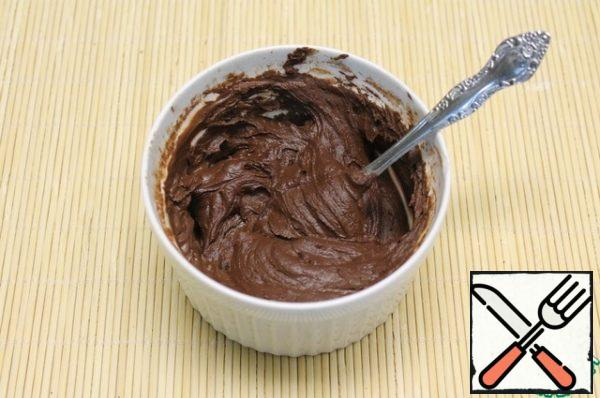 DOUGH: heat Milk (almost to a boil) and pour into cocoa. Mix thoroughly. Get a thick mass.