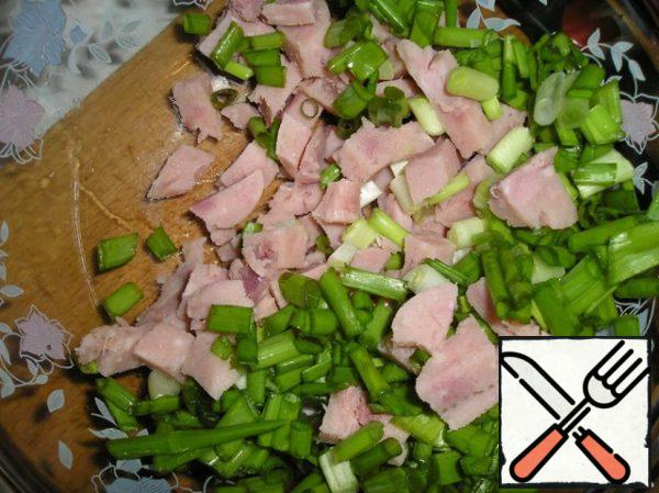 Cut the ham into cubes. Greens cut with a scissors.