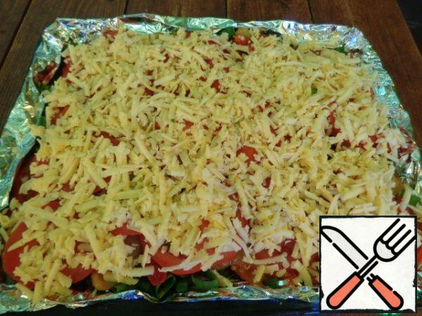 Cheese shred on a large grater and spread on top of the tomato-Golden crust will be provided.