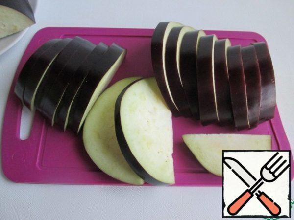 Cut eggplant into slices.