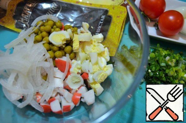 Crab sticks (meat) cut into cubes, add green peas, pickled onions. 5 eggs chop, add.