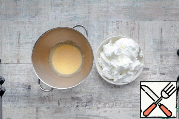 Separate the whites from the yolks. Beat the yolks with 2-3 tablespoons of olive oil. Whisk the whites separately in a cool foam.