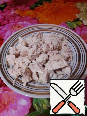 Cut chicken breast across the fibers.
