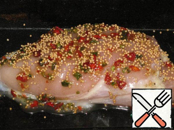 The breast is soaked in salt water for 2 hours (if the chicken breast, it is smaller, you can keep 1.5 hours, if very large, you can make injections of salt water )..Water should be salty, but not bitter. Stuff the meat with garlic. Honey, butter (you can take the usual), salt (a little), mustard, paprika and pepper make a paste.Coat the meat.Spread on a baking sheet.