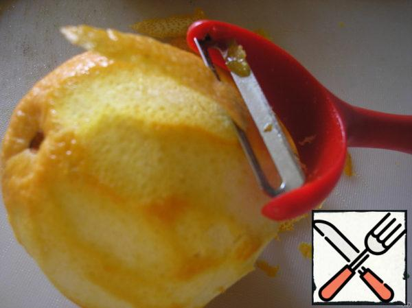 Use the vegetable peeler to remove the zest from the oranges and lemons.