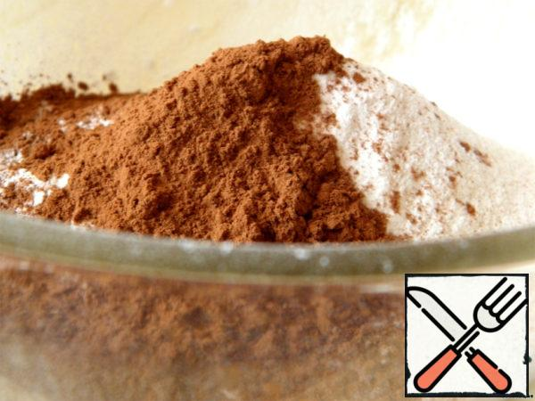 In a bowl sift flour and baking powder, add salt and cocoa powder.