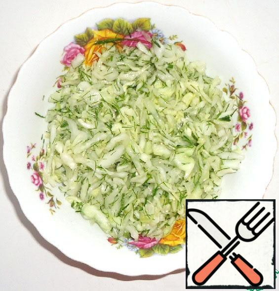 In a deep salad bowl combine cabbage and dill. Add sugar, salt, lemon juice and mix well, let stand for 20 minutes, then add olive oil and mix well.