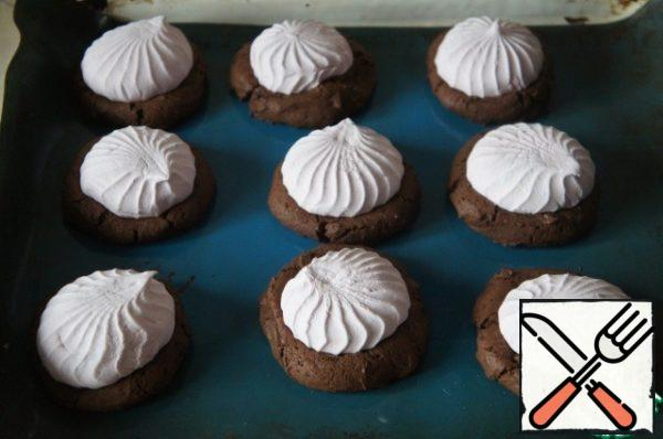 Return to the oven and continue baking until the marshmallow starts to melt, from 2 to 3 minutes.