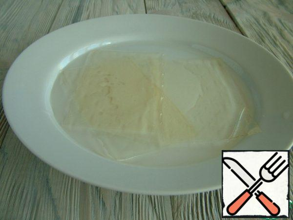 Gelatin (3 plates) should be soaked in 70 g of cold water for 10 minutes.