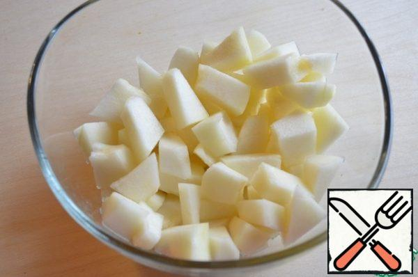 Cut the fragrant melon into cubes and place in a container.