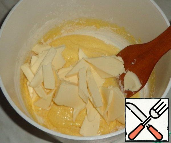Cut into small pieces softened butter, add to the dough and beat.