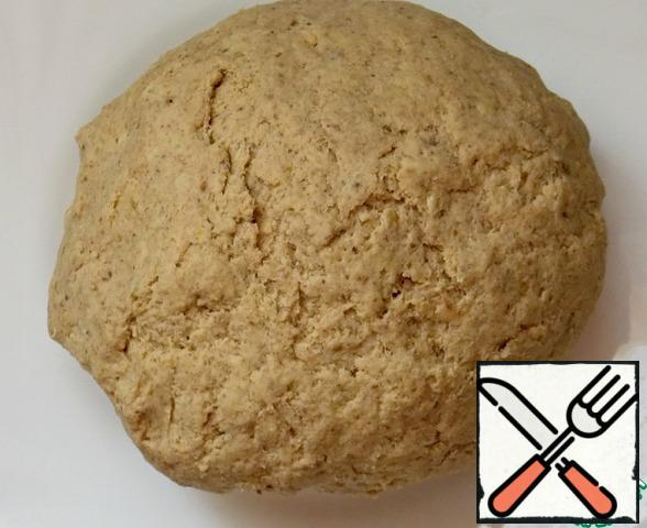 Then add both flour, baking powder (not soda! ) and knead the dough. It should get soft, but not stick to your hands.