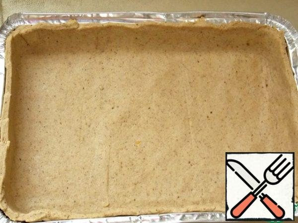 Then roll out the dough and put in a form.
