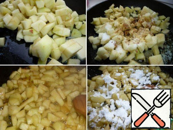 Preparing the stuffing. In a frying pan put butter, apples (peel and seeds, cut into cubes), lemon zest, sugar and cinnamon. Put out without a lid for 5 minutes stirring regularly. Then add starch, stir, remove from heat and cool.
