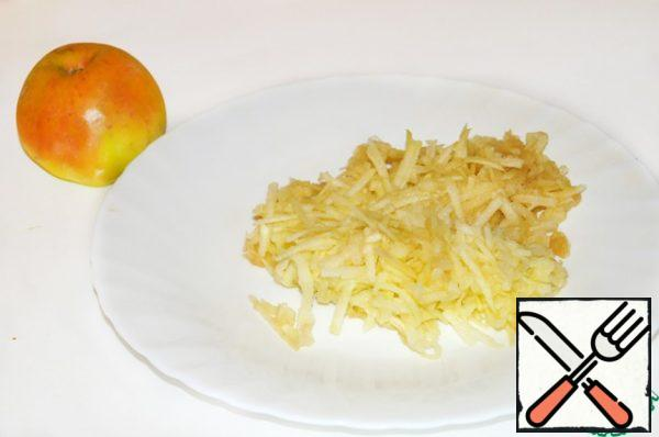 Wash the Apple (I peeled it), grate it, add to carrots and mix.
