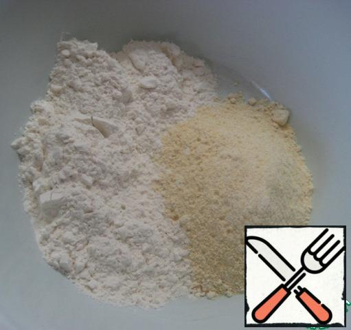 In a bowl, mix two kinds of flour and a pinch of salt.