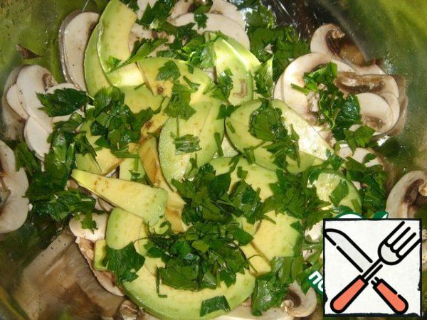 Large slices of avocado cut, add to the mushrooms. Sprinkle with herbs. I used parsley instead of mint.