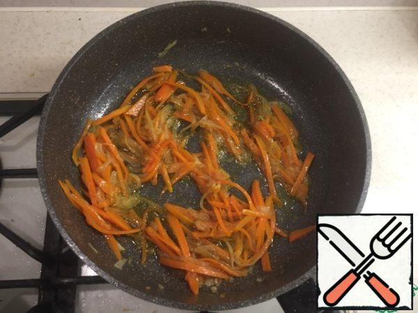 In a separate pan fry onions and carrots, add soy sauce. I add a pinch of sugar for more flavor disclosure.