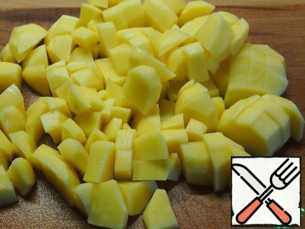 Peel and dice the potatoes. Add potatoes to the broth and cook until almost ready.