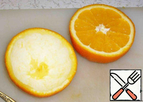 Cut the orange into two equal parts.
