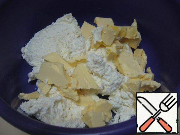 Grind the cottage cheese with softened butter (do not heat the butter!).