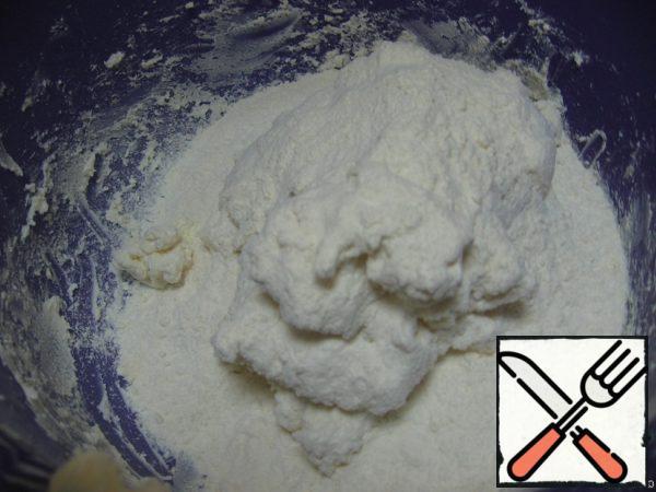 Add the sifted flour, stir until smooth.