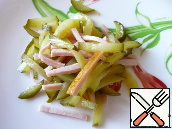 Pork, pickled cucumbers cut into small cubes.