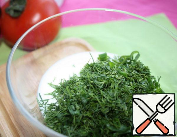 In sour cream add finely chopped herbs, mix.