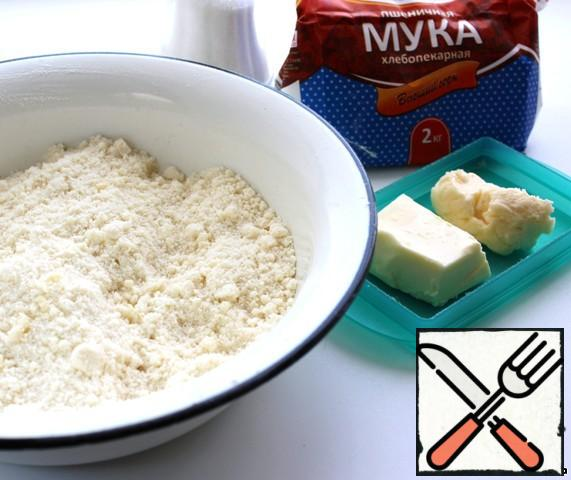 Flour with butter chop with a knife, add sugar, baking powder and fingers to grind into crumbs.