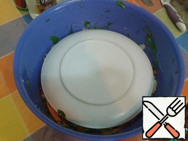 Stir, seal well, cover with a plate, lightly press down and let stand for 1 hour.