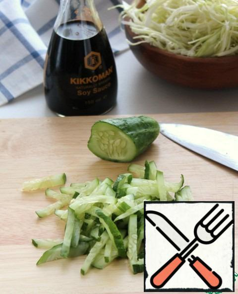 Cut the cucumbers into strips.