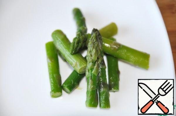 "Take asparagus, I have frozen, and cut into ""sticks"" about 5 cm long. Boil for a couple of minutes in boiling water. Asparagus should remain slightly crispy."