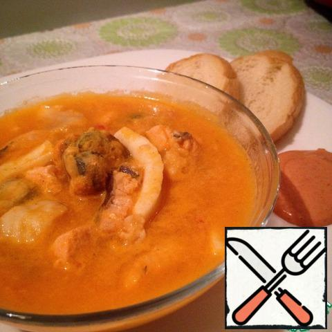 Cut the baguette into slices, grease on one side with olive oil, dry in the oven. RUB the oil side of the garlic. Soup served with croutons and dressing in separate bowl.