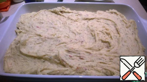 When the puree is smooth, shift it into a baking dish.