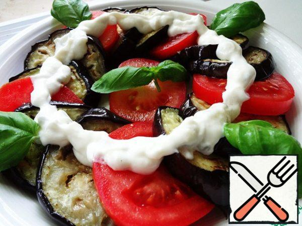 Spread the sauce on top of the vegetables. Decorate with Basil. Cool before serving.