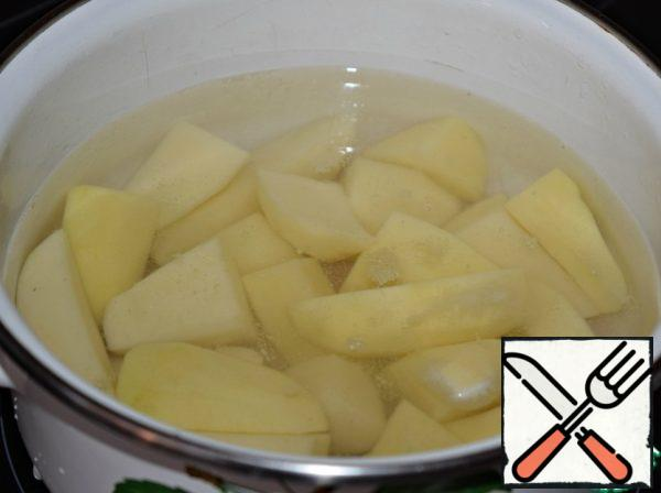 Peel the potatoes and boil until tender. Mash into puree.