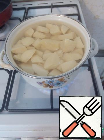 Pour hot water from the tap to reduce the cooking time. Cook on medium heat until potatoes are ready.