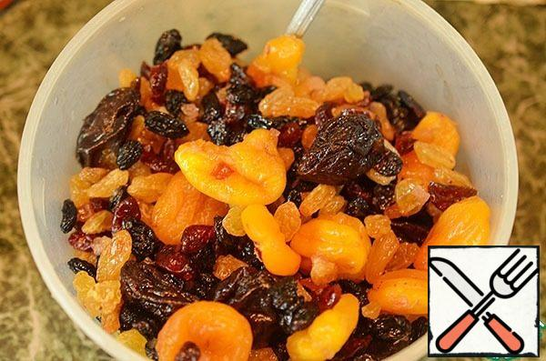 Wash dried fruits with hot water, throw them on a sieve. Then pour 200 ml of brandy and let steep for at least a day.